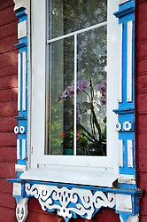 "Beautiful traditional wood scrolls decorate a window in Uglich, Russia. As one of Russia's ""Golden Ring"" cities, Uglich is designated a town of significant cultural and historic importance."