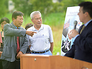 From left, Simon Paek points to a poster as he speaks with Dong Kim as Congressman Brendan Boyle (right) makes remarks during the groundbreaking ceremony for the construction of the Korean War Memorial, America-Korean Alliance Peace Park Tuesday, August 8, 2017 at Memorial Grove Park in North Wales, Pennsylvania. (WILLIAM THOMAS CAIN / For The Philadelphia Inquirer)