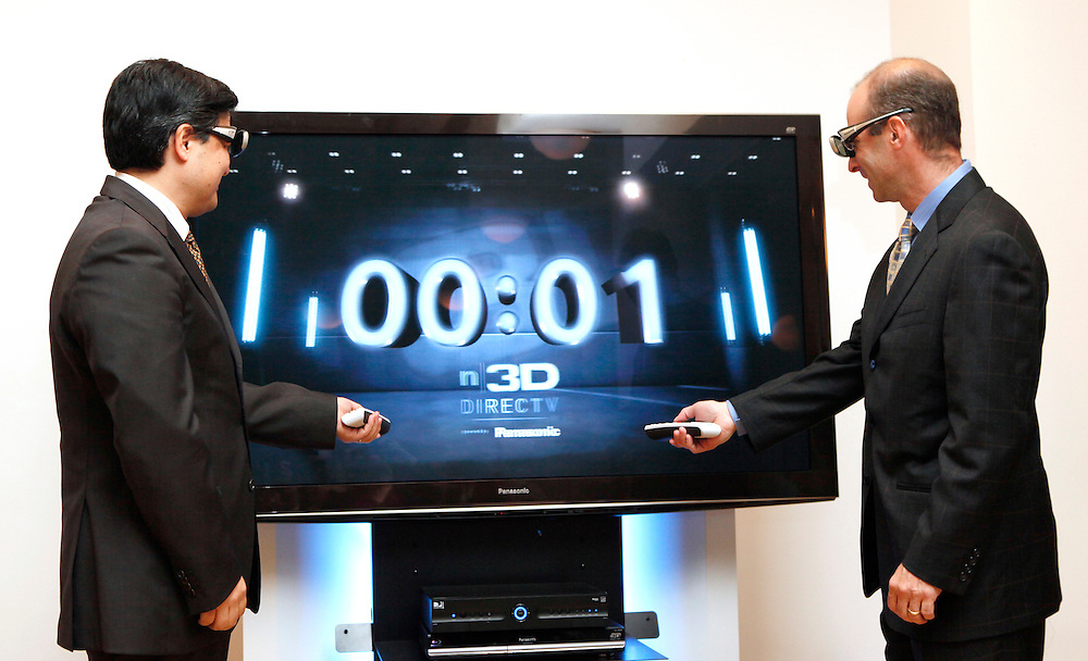In this photo from Panasonic, Shiro Kitajima, president Panasonic Consumer Electronics Company, left, and Steven Roberts, senior vice president DIRECTV, right, launch n3D powered by Panasonic, a DIRECTV channel dedicated exclusively to 3D programming and viewable on 3D television sets, New York, Thursday, July 1, 2010. (Photo/Panasonic/Stuart Ramson)