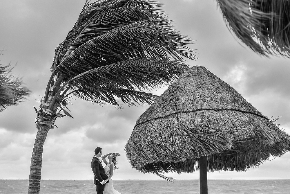 Maria & Greg in the middle of the storm at the Excellence Resort in Playa Mujeres Cancun, Mexico. Photo by: Juan Carlos Calderón.