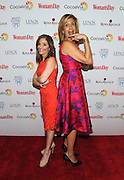 The Today Show's Joy Bauer, left, and Hoda Kotb, compare heights on the red carpet at Woman's Day Red Dress Awards, benefitting American Heart Association's Go Red For Women, Tuesday February 9, 2016, in New York. (Photo by Diane Bondareff/Invision for Go Red For Women/AP Images)