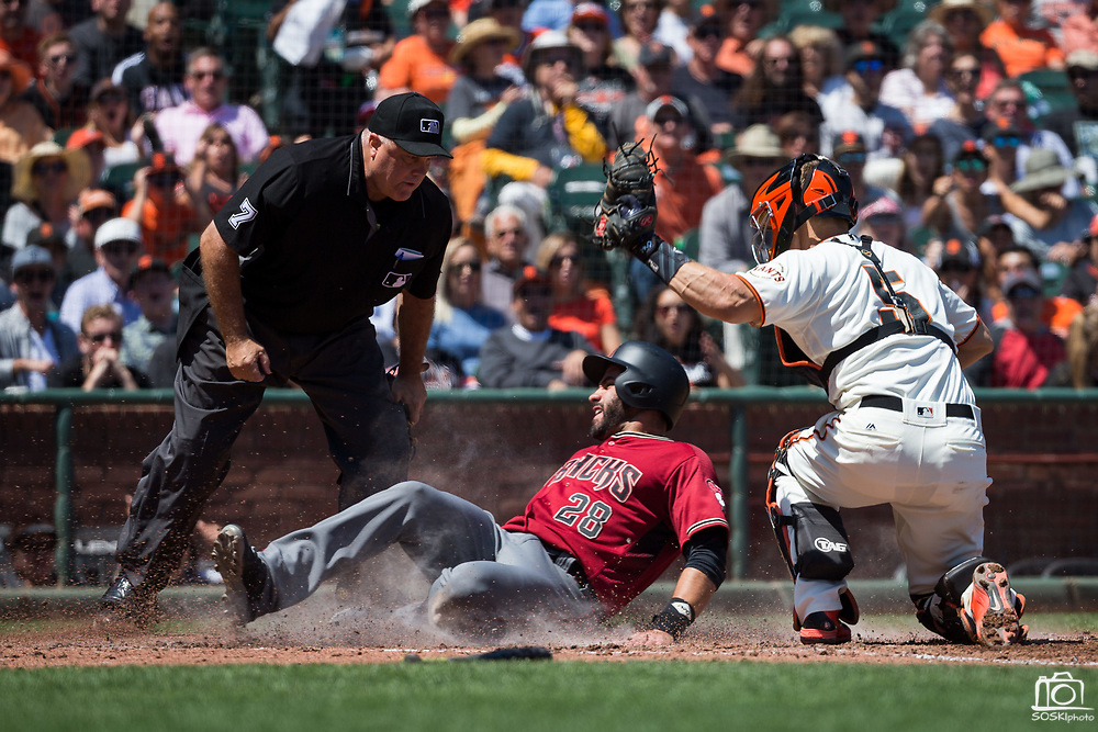 San Francisco Giants catcher Nick Hundley (5) tags Arizona Diamondbacks right fielder J.D. Martinez (28) out at home plate at AT&T Park in San Francisco, California, on August 6, 2017. (Stan Olszewski/Special to S.F. Examiner)
