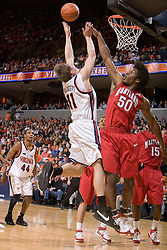 Virginia forward Laurynas Mikalauskas (11) shoots over Maryland forward Bambale Osby (50).  The Virginia Cavaliers defeated the Maryland Terrapins 91-76 at the University of Virginia's John Paul Jones Arena  in Charlottesville, VA on March 9, 2008.