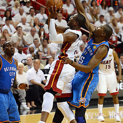 Jun 17, 2012; Miam, FL, USA; Miami Heat shooting guard Dwyane Wade (3) drives to the basket against Oklahoma City Thunder small forward Kevin Durant (35) during the second half in game three in the 2012 NBA Finals at the American Airlines Arena. Miami won 91-85. Mandatory Credit: Derick E. Hingle-US PRESSWIRE