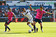 Kyle Naughton (26) of Swansea City is challenged by Geoff Cameron (5) of Queens Park Rangers during the EFL Sky Bet Championship match between Swansea City and Queens Park Rangers at the Liberty Stadium, Swansea, Wales on 29 September 2018.