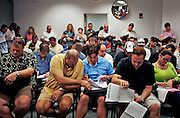 At the Lee County courthouse, a room is crammed with investors looking to pay rock-bottom prices on foreclosed homes. The foreclosed home buying business is booming in Southwest Florida, and shows few signs of letting up. Greg Kahn/Staff