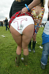 A fan with a coloured T her pants near the main stage area at T in the Park Saturday 8 July 2006, at Balado, Fife...