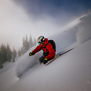 Tigger Knecht skis blower powder with a clearing storm in-bounds at JHMR.