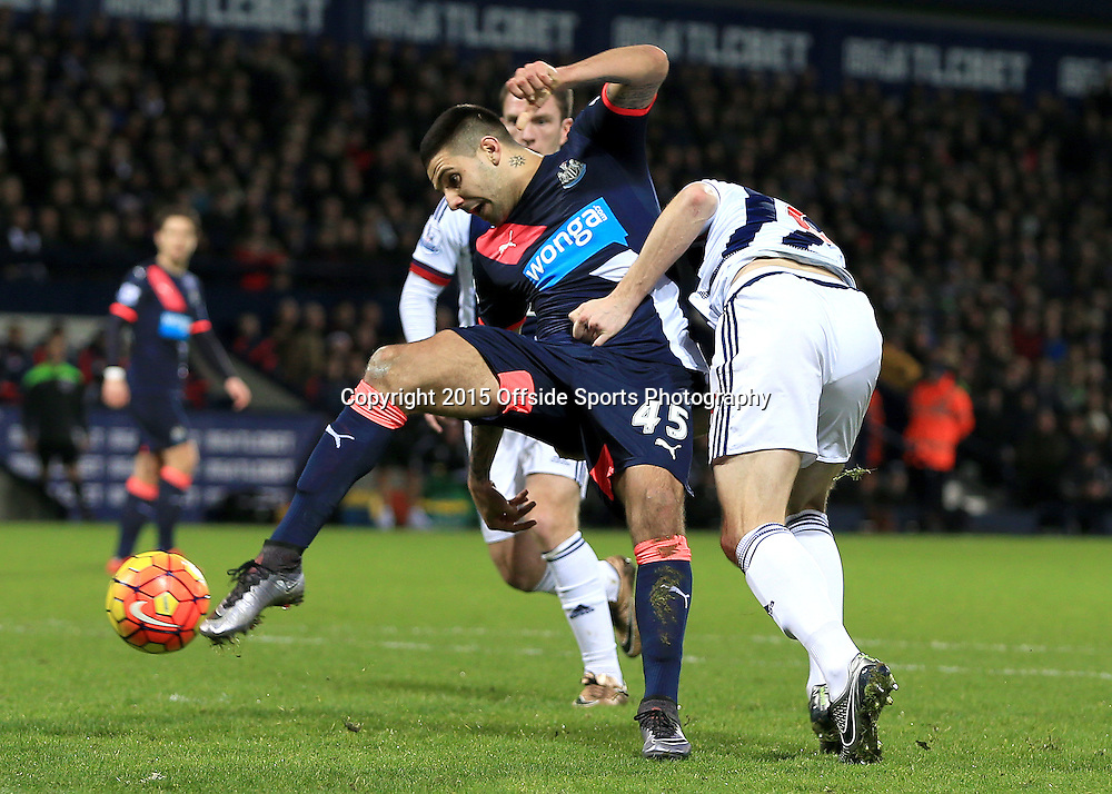 28th December 2015 - Barclays Premier League - West Bromwich Albion v Newcastle United - Aleksandar Mitrovic of Newcastle United gets a shot away as he is held by Jonny Evans of West Bromwich Albion - Photo: Paul Roberts / Offside.