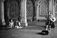 Accordion player WeiLi Xiao at Bethesda Terrace, Central Park