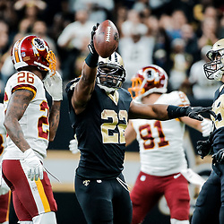 Nov 19, 2017; New Orleans, LA, USA; New Orleans Saints running back Mark Ingram (22) signals for a first down during overtime of a game against the Washington Redskins at the Mercedes-Benz Superdome. The Saints defeated the Redskins 34-31 in overtime. Mandatory Credit: Derick E. Hingle-USA TODAY Sports
