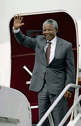 June 19, 2015 - Washington, District of Columbia, United States of America - Washington, DC. 6-24-1990.Nelson Mandela along with his then wife Winnie arrive at Washington DC's National Airport. He is greeted by Randall Robinson the founder of Transafrica and Effie Barry the wife of Washington DC Mayor Marion Barry, and Congressman Walter Fountry (D-DC).Credit: Mark Reinstein (Credit Image: © Mark Reinstein via ZUMA Wire)