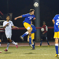 Photos by Tom Kelly IV<br /> West's Reilly Rodriguez (29) goes up for a header during the Downingtown West vs West Chester Rustin boys District One semifinal soccer game which was held Wednesday night October 30, 2013 at West Chester East High School.