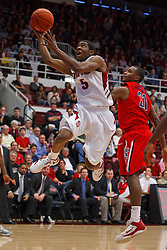 Feb 4, 2012; Stanford CA, USA;  Stanford Cardinal guard Chasson Randle (5) shoots past Arizona Wildcats guard Kyle Fogg (21) during the first half at Maples Pavilion.  Mandatory Credit: Jason O. Watson-US PRESSWIRE