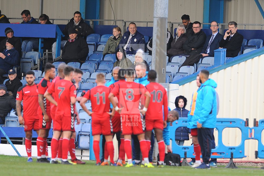 TELFORD COPYRIGHT MIKE SHERIDAN 1/1/2019 - Telford directors including Ian Dosser and Luke Fearnall (top right) watch on as Gavin Cowan delivers an impromptu team talk during a break in play during the Vanarama Conference North fixture between AFC Telford United and Nuneaton Borough FC.
