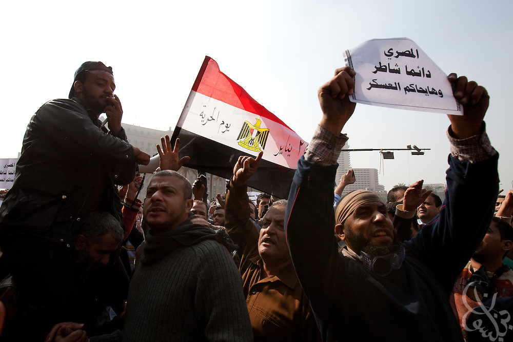 Egyptian protesters chant against military rule November 22, 2011 in Tahrir square in central Cairo, Egypt. Thousands of protestors demanding the military cede power to a civilian government authority clashed with Egyptian security forces for a fourth straight day in Cairo, with hundreds injured and at least 29 protestors killed so far.  (Photo by Scott Nelson)