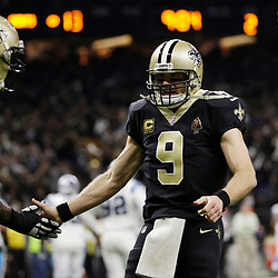 Jan 7, 2018; New Orleans, LA, USA; New Orleans Saints quarterback Drew Brees (9) reacts after throwing a pass for a touchdown against the Carolina Panthers during the second quarter in the NFC Wild Card playoff football game at Mercedes-Benz Superdome. Mandatory Credit: Derick E. Hingle-USA TODAY Sports