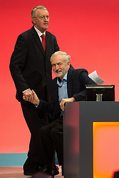 © Licensed to London News Pictures . 28/09/2015 . Brighton , UK . HILARY BENN shakes hands with JEREMY CORBYN after speaking at the 2015 Labour Party Conference . Photo credit : Joel Goodman/LNP