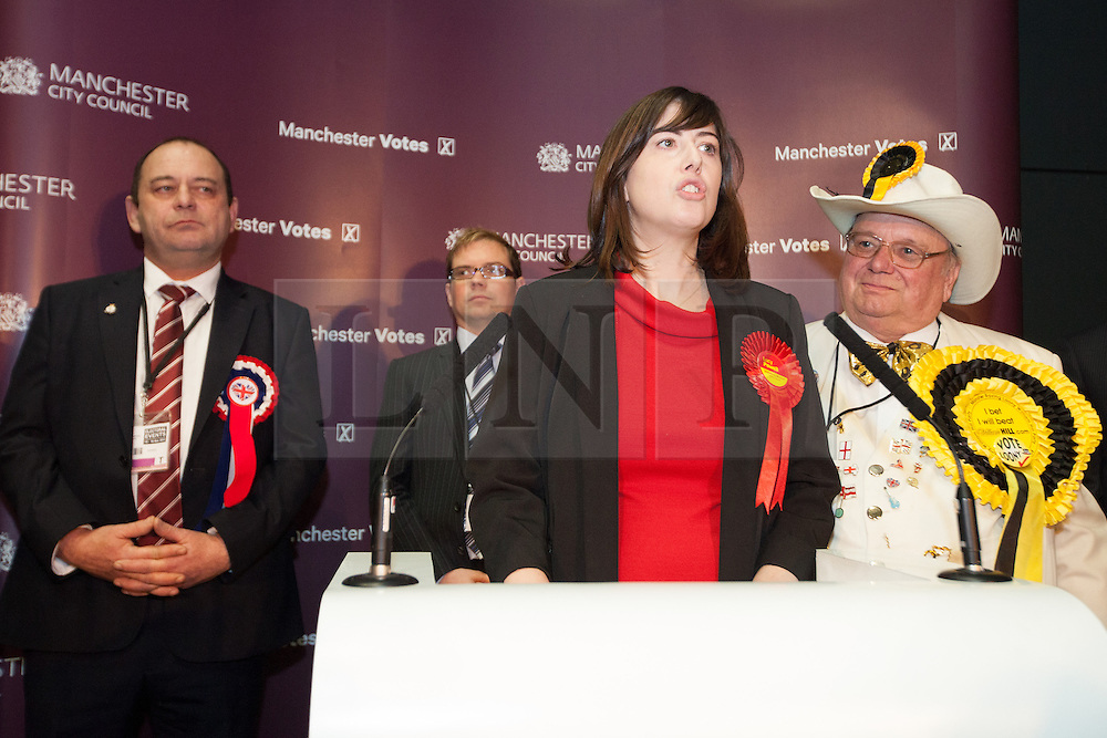 © Licensed to London News Pictures . 16/11/2012 . Manchester , UK . Labour's Lucy Powell gives her victory speech . Behind, l-r: Eddy O'Sullivan (BNP), Matthew Sephton (Conservative) and Howling Laud Hope (Monster Raving Loony William Hill Party). Manchester Central by election result at Manchester Central Convention Centre . Photo credit : Joel Goodman/LNP