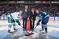 PENTICTON, CANADA - SEPTEMBER 8: Vancouver Canucks GM Trevor Linden and City of Penticton Mayor Andrew Jakubeit drop the puck between Brock Boeser #6 of Vancouver Canucks and Jansen Harkins #58 of Winnipeg Jets on September 8, 2017 at the South Okanagan Event Centre in Penticton, British Columbia, Canada.  (Photo by Marissa Baecker/Shoot the Breeze)  *** Local Caption ***