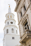 St. Michael's Episcopal Church steeple framed by the Old US Post Office in Charleston.