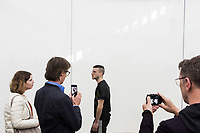 "VENICE, ITALY - 10 MAY 2017: Visitors photograph Anne Imhof's performance in the German Pavillon at the 57th International Art Exhibition in Venice, Italy, on May 10th 2017.<br /> <br /> The 57th International Art Exhibition, titled VIVA ARTE VIVA and curated by Christine Macel, is organized by La Biennale di Venezia chaired by Paolo Baratta. ""Viva Arte Viva is an exclamation, a passionate outcry for art and the state of the artist. Viva Arte Viva is a Biennale designed with artists, by artists and for artists, about the forms they propose, the questions they ask, the practices they develop and the ways of life they choose"", Christine Macel says. <br />  <br /> Rather than broaching a single theme, Viva Arte Viva offers a route that moulds the artists' works and a context that favours access and understanding, generating connections, resonances and thoughts. VIVA ARTE VIVA will unfold over the course of nine chapters or families of artists, beginning with two introductory realms in the Central Pavilion, followed by another seven across the Arsenale through the Giardino delle Vergini. 120 are the invited artists from 51 countries; 103 of these are participating for the first time. <br /> <br /> The Exhibition will also include 85 National Participations in the historic Pavilions at the Giardini, at the Arsenale and in the historic city centre of Venice. 3 countries will be participating for the first time: Antigua and Barbuda, Kiribati, Nigeria."