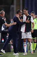 Juventus's Italian Head coach Maurizio Sarri compliment Portuguese striker Cristiano Ronaldo as he is substituted during the Serie A match at Luigi Ferraris, Genoa. Picture date: 30th June 2020. Picture credit should read: Jonathan Moscrop/Sportimage