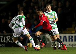 Manchester United's Alexis Sanchez (centre) and Yeovil Town's Jared Bird (left) battle for the ball during the Emirates FA Cup, fourth round match at Huish Park, Yeovil.