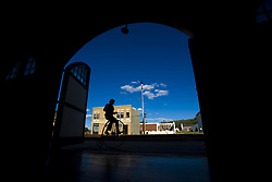 July 21, 2019 - Silhouette Of Man Riding Old Fashioned Bicycle Down Small Town Street (Credit Image: © Richard Wear/Design Pics via ZUMA Wire)