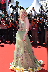 Elle Fanning arriving on the red carpet of 'How to Talk to Girls at Parties' screening held at the Palais Des Festivals in Cannes, France on May 21, 2017 as part of the 70th Cannes Film Festival. Photo by Nicolas Genin/ABACAPRESS.COM