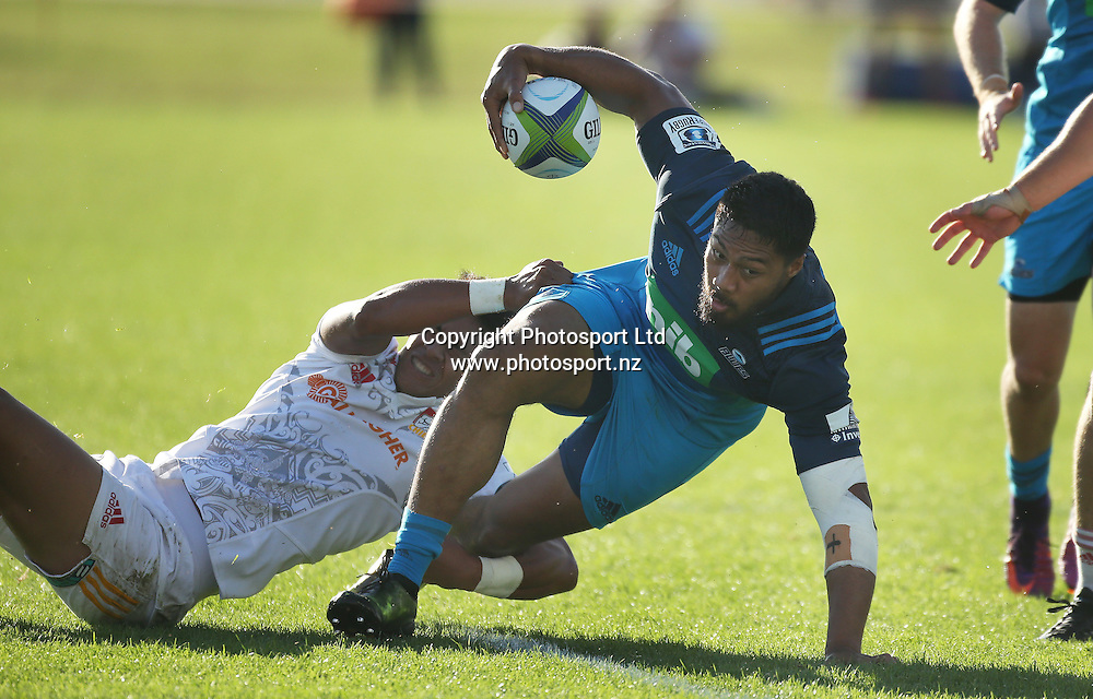 Blues player George Moala avoids the tackle of Chiefs player Solomon Alaimalo during the Blues vs Chiefs pre season Super Rugby match played at Alexandra Park in Auckland on the 17th February 2017. <br /> Credit; Peter Meecham/ www.photosport.nz
