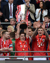 Bristol City's Joe Bryan lifts the JPT trophy  - Photo mandatory by-line: Joe Meredith/JMP - Mobile: 07966 386802 - 22/03/2015 - SPORT - Football - London - Wembley Stadium - Bristol City v Walsall - Johnstone Paint Trophy Final
