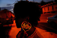 Shekita McCallister, 16, sports earrings with the name of her dead 2-year-old brother, September, 18, 2006.  She has joined the Peaceoholics, an organization aimed at quelling violence in Washington, D.C. (photo by Katherine Frey/The Washington Post)