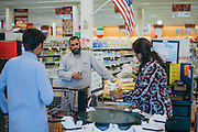 Gulab checks out at the grocery store in Arlington, Texas on May 6, 2016. With respect to his religion, Gulab travels over 30 minutes to the closest store that caters to the muslim population