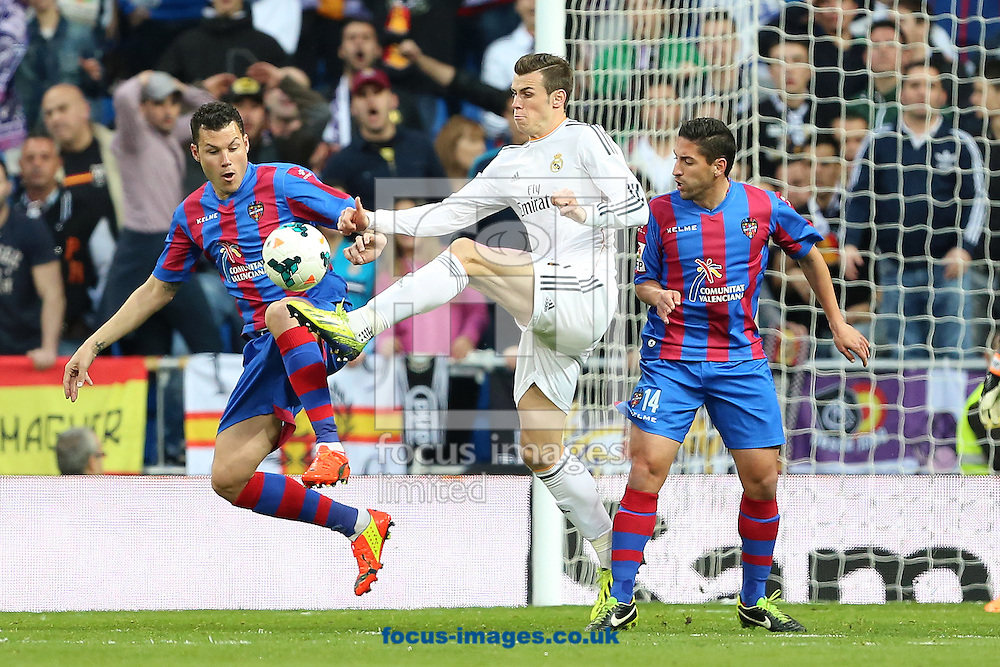 Gareth Bale of Real Madrid and David Navarro of Levante Union Deportiva fight for the ball during the La Liga match at the Estadio Santiago Bernabeu, Madrid<br /> Picture by Richard Calver/Focus Images Ltd +447792 981244<br /> 09/03/2014