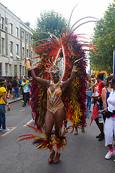 London, August 29th 2016. A participant makes his way along the procession route during day two of Europe's biggest street party, the Notting Hill Carnival.