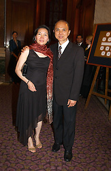 MR & MRS JIMMY CHOO at a fashion show and dinner hosted by Shangri-la Hotels and Resorts and Andy Wong featuring fashion by new designer Lu Kun held at The Goldsmiths Hall, Foster Lane, London on 25th April 2005.<br /><br />NON EXCLUSIVE - WORLD RIGHTS