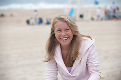 teenage girl on the beach smiling