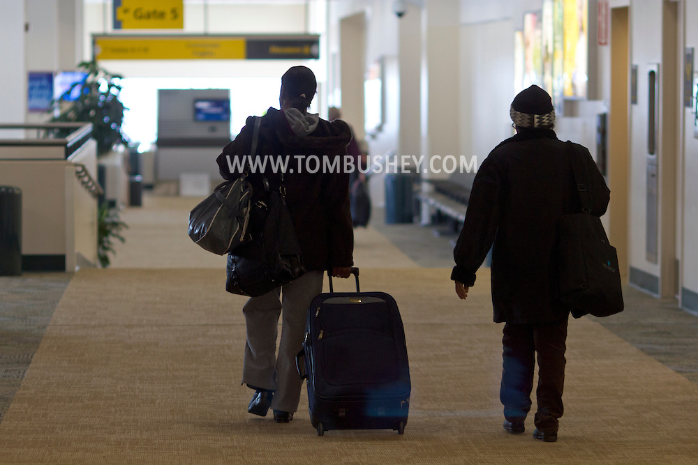 New Windsor, New York - Two passengers walk through at Stewart International Airport on Jan. 26, 2013.