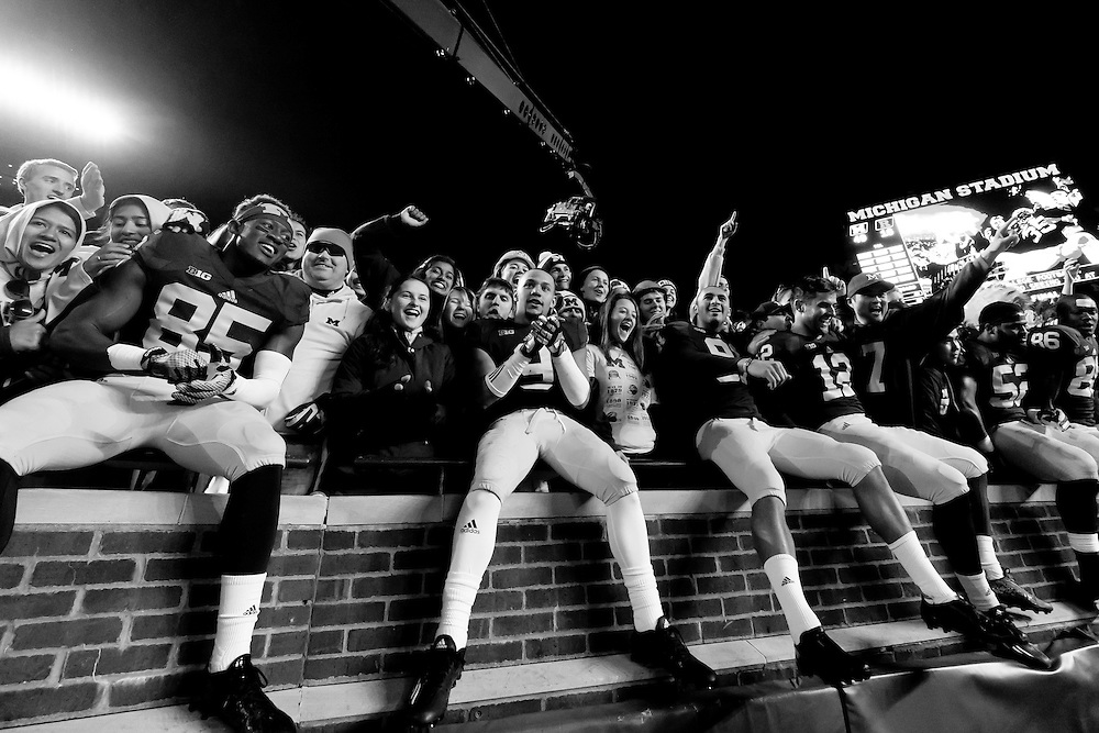 Nov 7, 2015; Ann Arbor, MI, USA; Michigan Wolverines players celebrate in the student section after the game against the Rutgers Scarlet Knights at Michigan Stadium. Michigan won 46-16. Mandatory Credit: Rick Osentoski-USA TODAY Sports