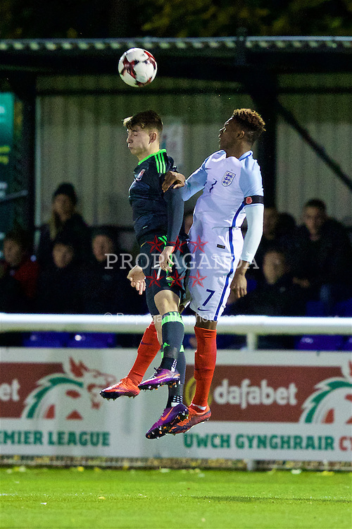 BANGOR, WALES - Saturday, November 12, 2016: Wales' Ben Woodburn in action against England's Dujon Sterling during the UEFA European Under-19 Championship Qualifying Round Group 6 match at the Nantporth Stadium. (Pic by Gavin Trafford/Propaganda)