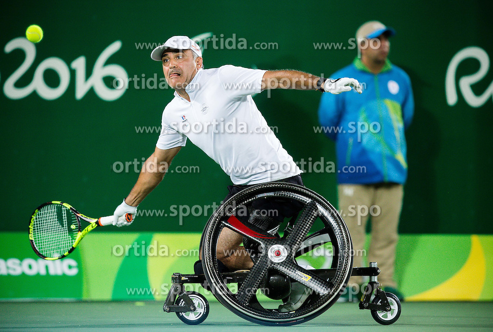 Stephane Houdet  and Nicolas Peifer (out of frame) of France play against Alfie Hewett (out of frame) and Gordon Reid (out of frame) of the UK in the Tennis Men's Doubles Gold Medal Match during Day 8 of the Rio 2016 Summer Paralympics Games on September 15, 2016 in Olympic Tennis Centre, Rio de Janeiro, Brazil. Photo by Vid Ponikvar / Sportida