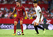 SEVILLE, SPAIN - AUGUST 10:  Kevin Strootman of AS Roma (L) being followed by Joaquin Correa of Sevilla FC (R) during a Pre Season Friendly match between Sevilla FC and AS Roma at Estadio Ramon Sanchez Pizjuan on August 10, 2017 in Seville, Spain. (Photo by Aitor Alcalde/Getty Images)