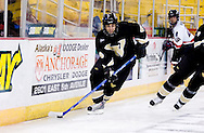 October 13, 2007 - Anchorage, Alaska: Ryan Bernardi (4) of the Wayne State Warriorsin their game three 4-1 loss to the Robert Morris University Colonials at the Nye Frontier Classic at the Sullivan Arena.