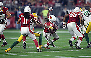 Arizona Cardinals running back Andre Ellington (38) gets a block from Arizona Cardinals tight end Darren Fells (85) and Arizona Cardinals wide receiver Larry Fitzgerald (11) as he tries to avoid a tackle attempt by Green Bay Packers strong safety Morgan Burnett (42) as he runs up the middle in the first quarter during the NFL NFC Divisional round playoff football game against the Green Bay Packers on Saturday, Jan. 16, 2016 in Glendale, Ariz. The Cardinals won the game in overtime 26-20. (©Paul Anthony Spinelli)