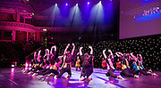 """DANCE PROMS 2011 <br /> Photograph by Elliott Franks <br /> 13th November 2011 <br /> at The Royal Albert Hall<br /> pictures backstage, rehearsals &during performance<br /> Behind every great dancer is an inspirational dance teacher.<br /> <br /> Dance Proms is a unique and exciting collaborative project that celebrates the wealth of talent among the nation's young dancers and culminates in a gala performance at the Hall.<br /> <br /> Dance Proms is a partnership project between the IDTA, ISTD, RAD and the Royal Albert Hall working together in celebration of dance. From Ballet to Tap, our gala performance will feature a diverse variety of acts to celebrate the dedication of the nation's dance teachers and to showcase their students' abilities. With the Royal Albert Hall as our setting, this is an amazing opportunity for our young dancers to perform at one of the most iconic venues in the country.<br /> <br /> Following an exciting Public Vote to decide on the final act to be selected to perform at the Hall, visit danceproms.co.uk or sign up to the E-book to follow the progress of the acts as they prepare for the Dance Proms and take advice from dance industry mentors including Casting Director, Mark Summers and Principal Dancer at The Royal Ballet, Steven McRae.<br /> <br /> Featuring guest appearances by Strictly Come Dancing's Darren Bennett & Lilia Kopylova and Principals of The Royal Ballet, Marianela Nuñez and Thiago Soares.<br /> <br /> """"Having been through the Strictly ballroom process myself, I not only have absolute respect for teachers, dancers and dance students - I know how exhilarating, rewarding and exciting a performance can be; throw in the Royal Albert Hall and you really do have a once in a lifetime opportunity!"""" - Chris Hollins<br /> <br /> """"It's the love of dance and joy of teaching that makes a project like Dance Proms so amazing. The relationship between a dance teacher and their student is very special and to be able to offer this opportunity"""