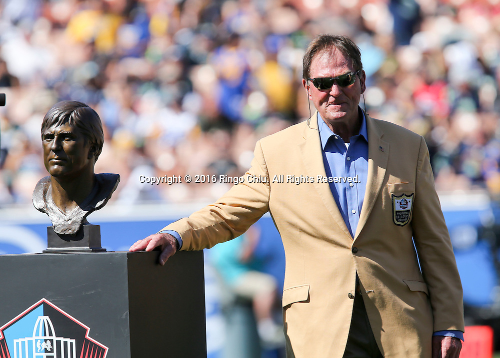 Former Rams team member Jack Youngblood stands with his bust looks at his bust during the Rams Hall of Fame Ring of Excellence ceremony at halftime of an NFL football game between the Rams and the Seattle Seahawks at the Los Angeles Memorial Coliseum, Sunday, Sept. 18, 2016, in Los Angeles.(Photo by Ringo Chiu/PHOTOFORMULA.com)<br /> <br /> Usage Notes: This content is intended for editorial use only. For other uses, additional clearances may be required.