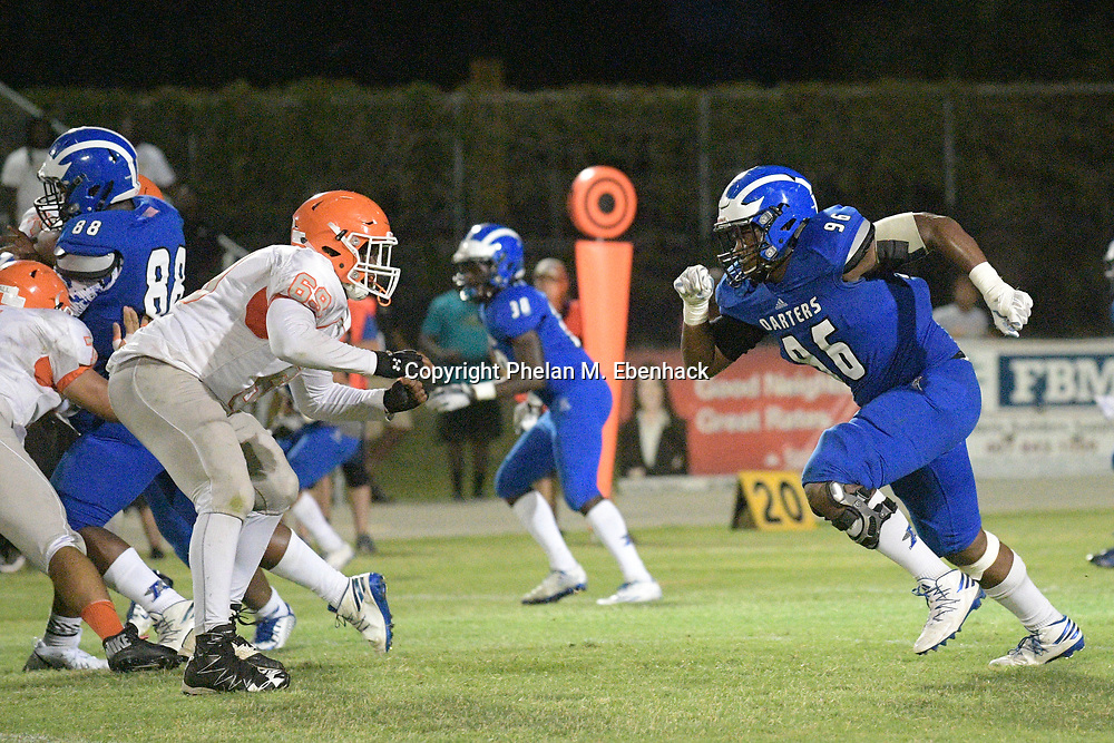 Apopka defensive lineman Mychal Austin (96) rushes the line of scrimmage against Orange City University offensive lineman Hayward Hooks (69) during the second half of a spring high school football game in Apopka, Fla., Thursday, May 25, 2017. (Photo by Phelan M. Ebenhack)