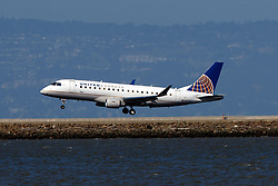 Embraer ERJ-175LR (N208SY) operated by SkyWest Airlines for United Express landing at San Francisco International Airport (KSFO), San Francisco, California, United States of America