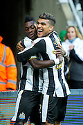 Newcastle United midfielder Christian Atsu (#30) celebrates Newcastle United's first goal (1-0) wtih Newcastle United defender DeAndre Yedlin (#22) during the EFL Sky Bet Championship match between Newcastle United and Cardiff City at St. James's Park, Newcastle, England on 5 November 2016. Photo by Craig Doyle.